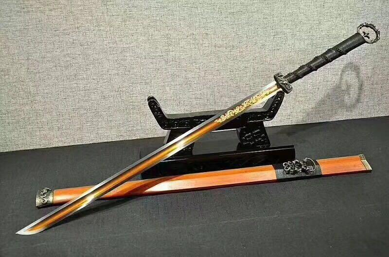 二,金钱镇宅宝剑 金钱镇宅宝剑是用古铜钱, 丝线手工制作.