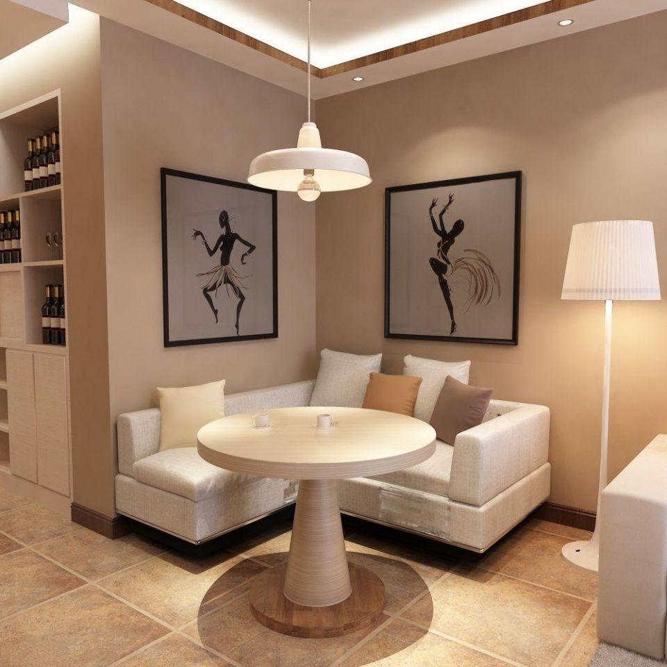 客厅的现代简约装修效果图:客厅吊棚不是很复杂,墙面大面积采用带颜色