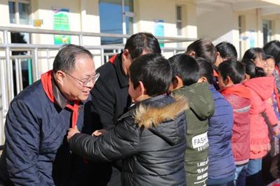 永明金融携手光大永明人寿为山西省革命老区贫困学校送温暖